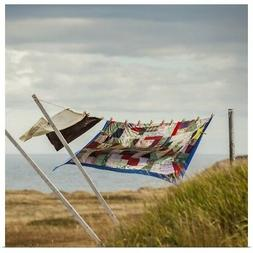Poster Print Wall Art entitled A patchwork blanket and pillo